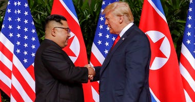 U.S. President Donald Trump shakes hands with North Korea leader Kim Jong Un at the Capella resort on Sentosa Island.