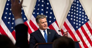 FBI Director Christopher Wray speaks during a news conference on the inspector general's report at FBI headquarters.