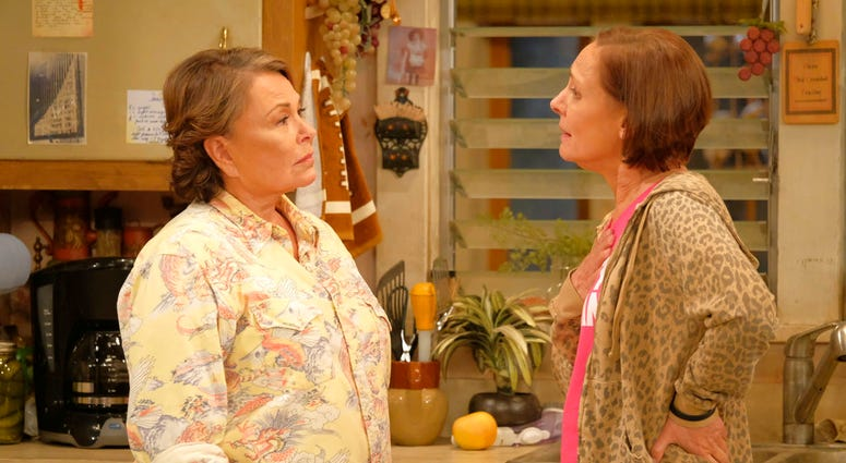 """In this image released by ABC, Roseanne Barr, left, and Laurie Metcalf appear in a scene from the reboot of the popular comedy series """"Roseanne."""""""