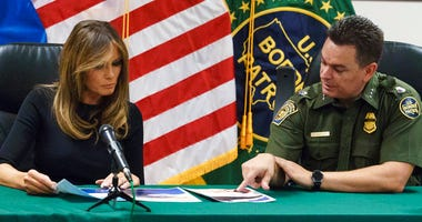 Rodolfo Karisch, Chief Patrol Agent TCA Border Patrol, right, talks with first lady Melania Trump during a roundtable discussion as she visits a U.S. Customs and border and protection facility in Tucson, Ariz.