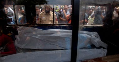 An ambulance carries one of the 11 dead bodies found in Burari village, north Delhi, India.