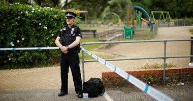 A British police officer guards a cordon outside the Queen Elizabeth Gardens park in Salisbury, England.