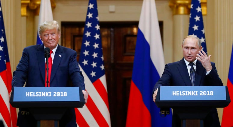 U.S. President Donald Trump, left, listens to Russian President Vladimir Putin during a press conference after their meeting at the Presidential Palace in Helsinki, Finland.