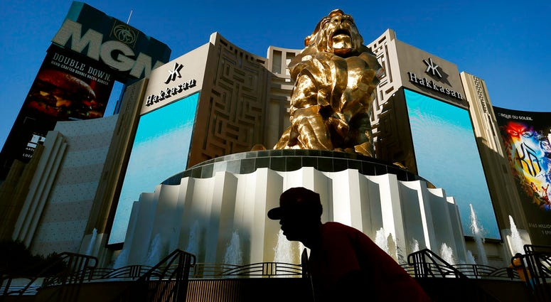 In this Aug. 3, 2015, file photo, a man rides his bike past the MGM Grand hotel and casino in Las Vegas.