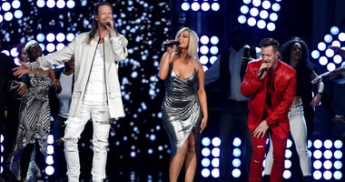"In this April 15, 2018 file photo, Tyler Hubbard, right, and Brian Kelley, left, of Florida Georgia Line, and Bebe Rexha, center, perform ""Meant to Be"" at the 53rd annual Academy of Country Music Awards in Las Vegas."