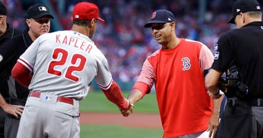 Boston Red Sox manager Alex Cora, right, shakes hands with Philadelphia Phillies manager Gabe Kapler (22) prior to the first inning of a baseball game at Fenway Park in Boston, Monday, July 30, 2018.