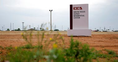 This June 30, 2015 file photo shows a sign at the entrance to the South Texas Family Residential Center in Dilley, Texas.