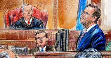 This courtroom sketch depicts Rick Gates on the witness stand as he is cross examined by defense lawyer Kevin Downing during the trial of former Donald Trump campaign chairman Paul Manafort on bank fraud and tax evasion at federal court in Alexandria, Va.