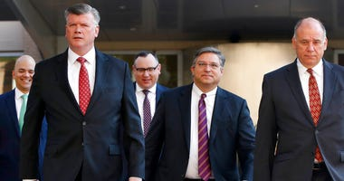 Members of the defense team for Paul Manafort, including from left, Jay Nanavati, Kevin Downing, Brian Ketcham, Richard Westling, and Thomas Zehnle, walk to federal court as the trial of the former Trump campaign chairman continues.