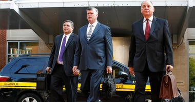 Defense attorneys Richard Westling, left, Kevin Downing, and Thomas Zehnle, walk to federal court as jury deliberations begin in the trial of former Trump campaign chairman Paul Manafort, in Alexandria, Va., Thursday, Aug. 16, 2018.