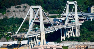 A view of the partially collapsed Morandi highway bridge, in Genoa, Italy, Sunday, Aug. 19, 2018.