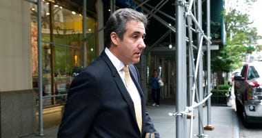 Michael Cohen, former personal lawyer to President Donald Trump, leaves his apartment building, in New York, Tuesday, Aug. 21, 2018.