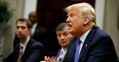 "President Donald Trump listens during a roundtable on the ""Foreign Investment Risk Review Modernization Act"" in the Roosevelt Room of the White House, Thursday, Aug. 23, 2018, in Washington."
