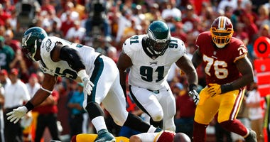 In this Sept. 10, 2017, file photo, Washington Redskins quarterback Kirk Cousins, bottom, fumbles in front of Philadelphia Eagles defensive tackle Fletcher Cox (91), defensive end Brandon Graham, left, and Redskins offensive tackle Morgan Moses (76).