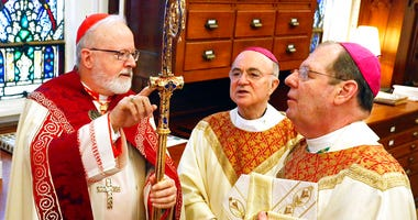 In this Feb. 14, 2014 file photo, from left, Sean Patrick Cardinal O'Malley, Archbishop of Boston; the Most Rev. Carlo Maria Viganò, apostolic nuncio to the United States, and the Most Rev. Robert Peter Deeley.