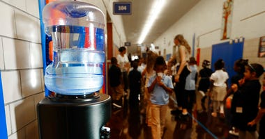 A bottled water dispenser sits in a hallway at Gardner Elementary School in Detroit, Tuesday, Sept. 4, 2018.