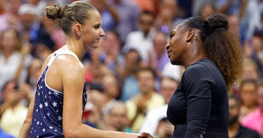 Serena Williams, right, of the United States, shakes hands with Karolina Pliskova, of the Czech Republic, after Williams' 6-4, 6-3 win during the quarterfinals of the U.S. Open tennis tournament Tuesday, Sept. 4, 2018, in New York.