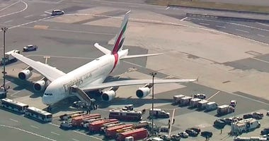 In this frame from video emergency response crews gather outside a plane at JFK Airport amid reports of ill passengers aboard a flight from Dubai on Wednesday, Sept. 5, 2018, in New York.