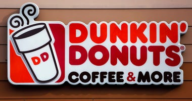 In this Jan. 22, 2018, file photo shows the Dunkin' Donuts logo on a shop in Mount Lebanon, Pa.
