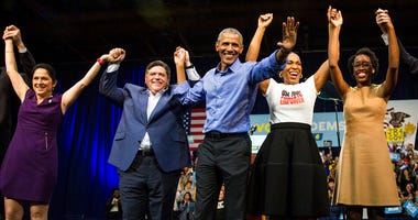 Obama, center, headlines a rally and appears alongside (from left) Illinois Comptroller Susana Mendoza, gubernatorial candidate J.B. Pritzker, lieutenant governor candidate Juliana Stratton and congressional candidate Lauren Underwood.