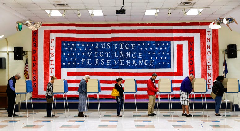 Voters cast their ballots at Robious Elementary School in Chesterfield, Va., on Tuesday, November 6, 2018.