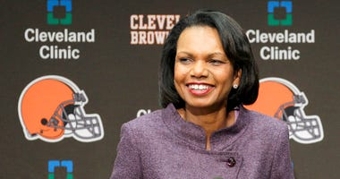 FILE- In this Oct. 21, 2010, file photo former Secretary of State Condoleezza Rice talks with the media after visiting with the Cleveland Browns coaches and players at the Browns training facility in Berea, Ohio.