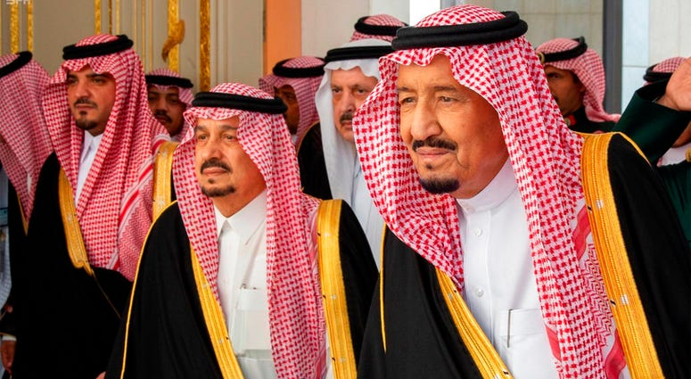 In this photo provided by the Saudi Press Agency, SPA, Saudi King Salman, right, with dignitaries before he gives his annual policy speech at the consultative Shura Council, Monday, Nov. 19, 2018, Riyadh, Saudi Arabia.