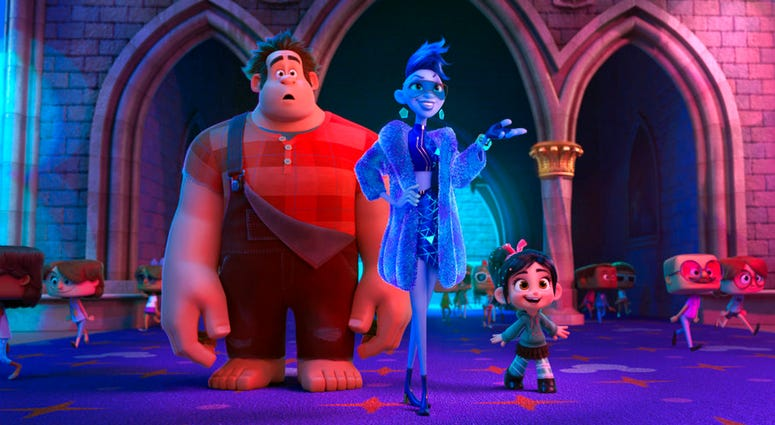 "FILE - This image released by Disney shows characters, from left, Ralph, voiced by John C. Reilly, Yess, voiced by Taraji P. Henson and Vanellope von Schweetz, voiced by Sarah Silverman in a scene from ""Ralph Breaks the Internet."" Studios on Sunday, Nov."