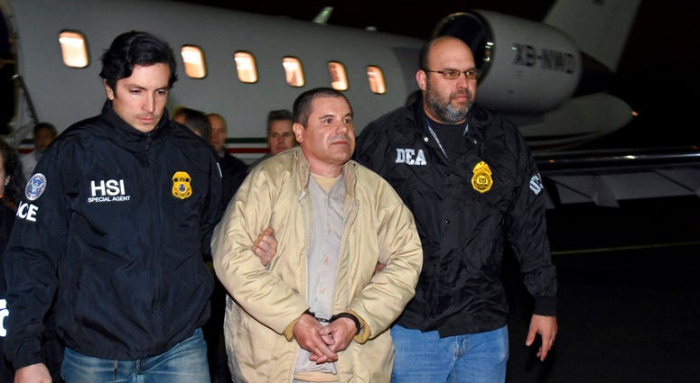 "FILE - In this Jan. 19, 2017, file photo, provided by U.S. law enforcement, authorities escort Joaquin ""El Chapo"" Guzman, center, from a plane to a waiting caravan of SUVs at Long Island MacArthur Airport, in Ronkonkoma, N.Y."
