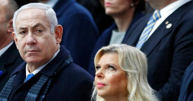 FILE - In this Nov. 11, 2018, file photo, Israeli Prime Minister Benjamin Netanyahu and his wife Sara attend ceremonies at the Arc de Triomphe in Paris.
