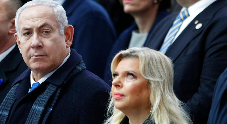 FILE - In this Nov. 11, 2018, file photo, Israeli Prime Minister Benjamin Netanyahu and his wife Sara attend ceremonies at the Arc de Triomphe in Paris.
