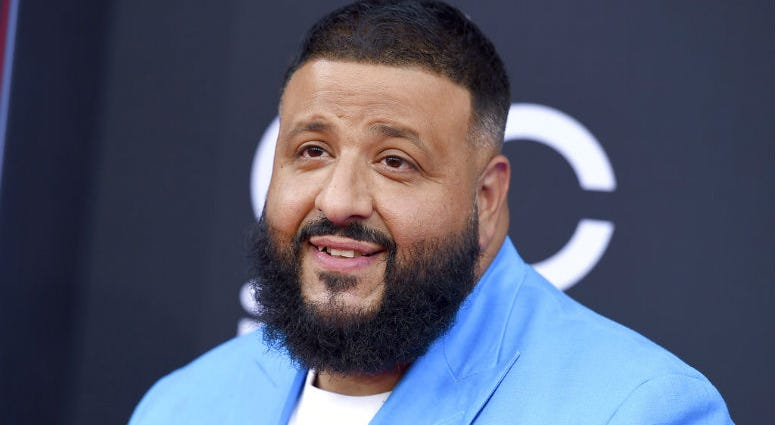 FILE - In this May 20, 2018 file photo, DJ Khaled arrives at the Billboard Music Awards in Las Vegas. Meek Mill, Busta Rhymes and Fat Joe were among the rappers that came out to celebrate DJ Khaled's birthday at an over-the-top party at the Perez Art Muse