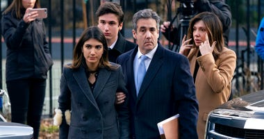 Michael Cohen, right, President Donald Trump's former lawyer, accompanied by his children and wife, arrive at federal court for his sentencing for dodging taxes, lying to Congress and violating campaign finance laws in New York on Dec. 12, 2018.