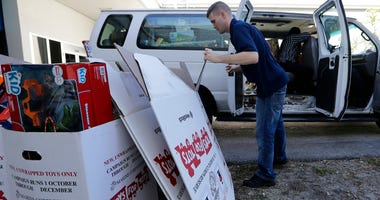 Stf. Sgt. Brian Spittler loads a vehicle with toy donations at the Marine Corps Toys for Tots depot, Wednesday, Dec. 19, 2018, in Hialeah, Fla.