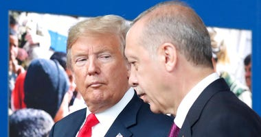 President Donald Trump talks to Turkish President Recep Tayyip Erdogan.