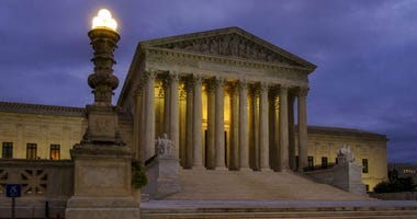 In this Oct. 5, 2018 photo the U. S. Supreme Court building stands quietly before dawn in Washington.