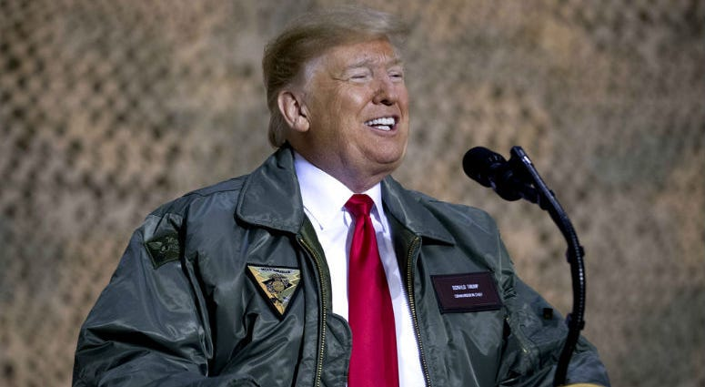 President Donald Trump speaks at a hanger rally at Al Asad Air Base, Iraq, Wednesday, Dec. 26, 2018.