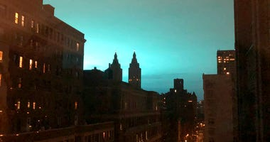 This photo shows blue light over New York, as seen from Manhattan Brough of New York on Thursday, Dec. 27, 2018.