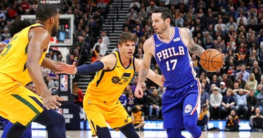 Philadelphia 76ers guard JJ Redick (17) is defended by Utah Jazz guard Kyle Korver (26) during the second quarter of an NBA basketball game Thursday, Dec. 27, 2018, in Salt Lake City.