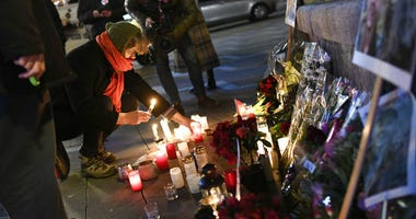 Flowers and candles are placed in memory of two Scandinavian university students who were killed in a remote area of the Atlas Mountains in Morocco, at the Town Hall Square in Copenhagen, Friday Dec. 28, 2018.