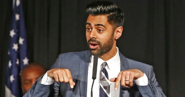 "FILE - In this May 10, 2017 file photo, Muslim-American comedian Hasan Minhaj cracks jokes for the audience after New York Mayor Bill de Blasio proclaimed May 10th as ""Hasan Minhaj Day,"" at Gracie Mansion, in New York."