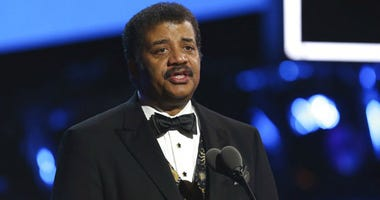FILE - In this Jan. 28, 2018, file photo, Neil deGrasse Tyson speaks at the 60th annual Grammy Awards at Madison Square Garden in New York.