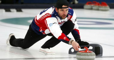In this Jan. 3, 2019 photo, former Minnesota Vikings football player Jared Allen practices with his curling team for a competition in Blaine, Minn.
