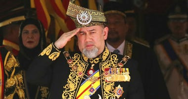 FILE - In this July 17, 2018, file photo, Malaysian King Sultan Muhammad V salutes during the national anthem at the opening of the 14th parliament session at the Parliament house in Kuala Lumpur, Malaysia.
