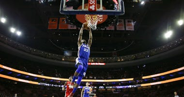 Philadelphia 76ers' Jimmy Butler goes up for a dunk during the first half of an NBA basketball game against the Washington Wizards, Tuesday, Jan. 8, 2019, in Philadelphia.
