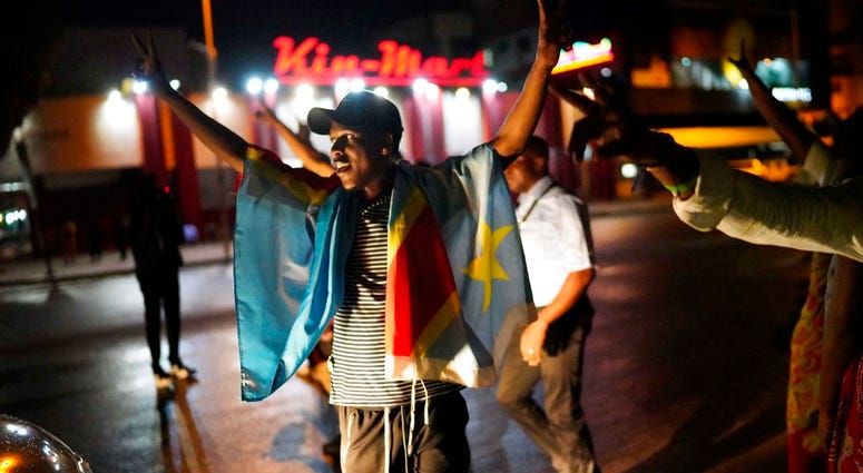 Kinshasa residents celebrate in Kinshasa Thursday Jan. 10, 2019, after learning that opposition presidential candidate Felix Tshisekedi had been declared the winner of the elections.