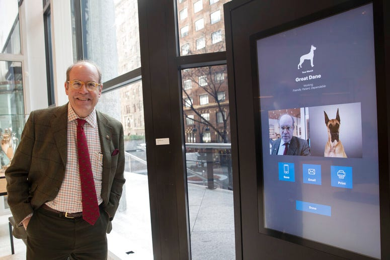 American Kennel Club Museum of the Dog's Executive Director Alan Fausel smiling after finding his dog breed match at the Find Your Match interactive kiosk.