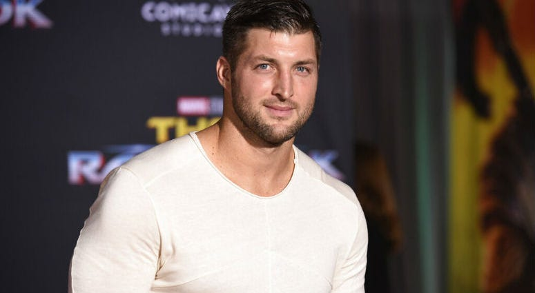 "FILE - In this Tuesday, Oct. 10, 2017 file photo, Tim Tebow arrives at the world premiere of ""Thor: Ragnarok"" at the El Capitan Theatre in Los Angeles."