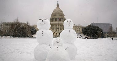 A snow family is seen on Capitol Hill as a winter storm arrives in the region, Sunday, Jan. 13, 2019, in Washington.