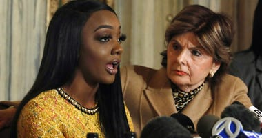 Faith Rodgers, left, accompanied by attorney Gloria Allred speaks during a news conference about R&B singer R. Kelly in New York, Monday, Jan. 14, 2019.